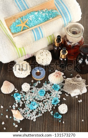 Sea spa elements on wooden table close up