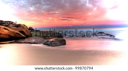 Sea stones at sunset - Sydney Australia - stock photo