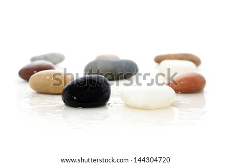 Sea stones isolated over white.