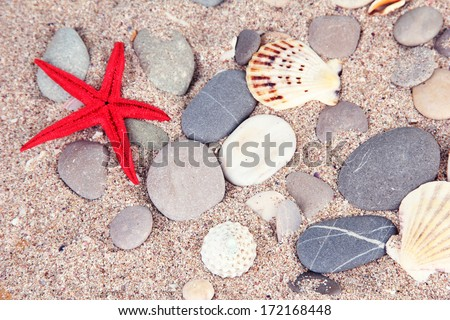Sea stones on sand background - stock photo