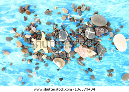 sea stones on the background water