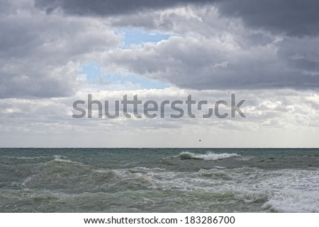 Sea Storm in a cloudy sky background - stock photo