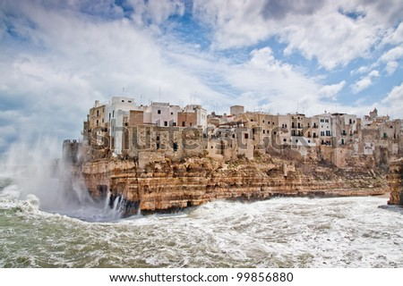 Sea storm over the wonderfull village of Polignano in south of italy