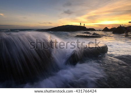 Sea sunrise. Amazing sea sunrise with slow shutter and waves flowing out . Colorful dawn over the sea. Nature composition.