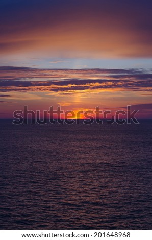Sea sunset with dramatic colors in Norway