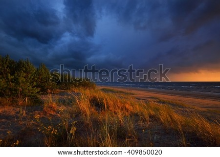 Sea sunset with dramatic stormy clouds - stock photo