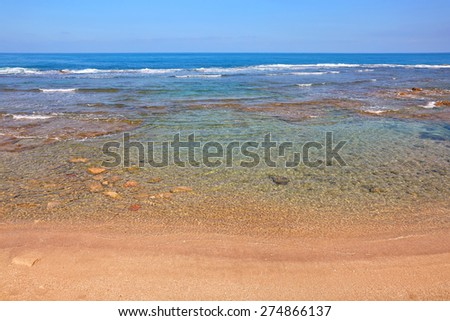 Sea surf and empty beach view