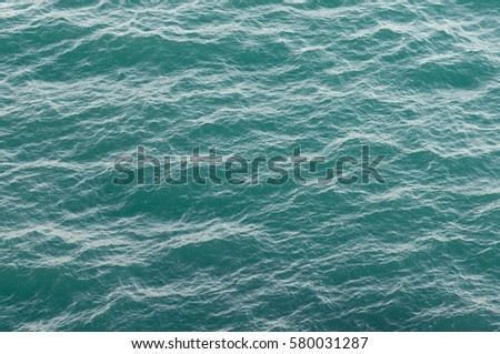 Sea texture. Water surface with waves turquoise. Abstract in nature. Background for design