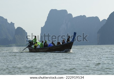 SEA, THAILAND - FEBRUARY 15: Unidentified Are traveling in the sea by boat on February 15, 2010. - stock photo