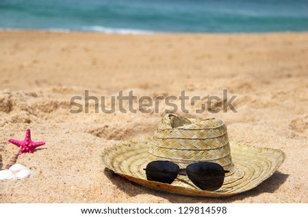 Sea time - seacoast and straw hat