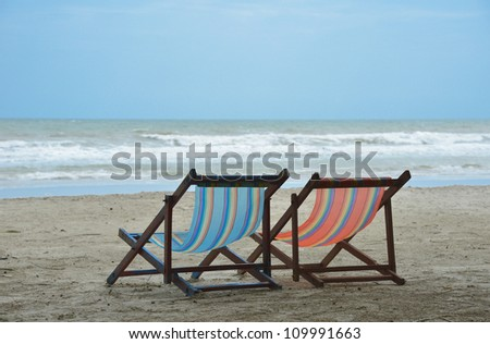 sea, tropical beach with chairs