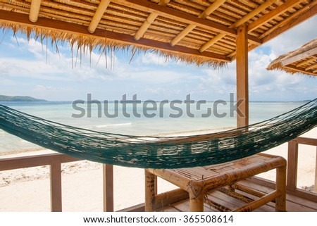 Sea view from huts, cottages, sunbeds and chairs - stock photo