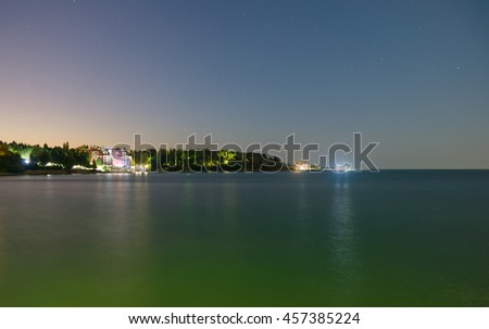 Sea view from the city at night with colored lights - stock photo