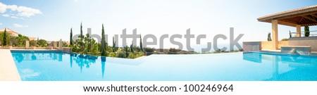 Sea view luxury swimming pool. Panoramic image - stock photo