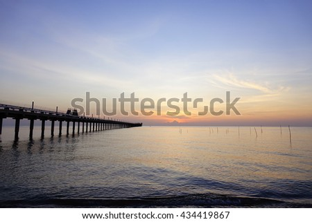 Sea view on morning time before sunrise with silhouette fishing pier on foreground,Close up,select focus with shallow depth of field:ideal use for background.