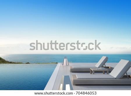 Sea view swimming pool terrace modernภาพประกอบสต็อก 704846053