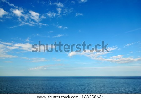 Sea view-wonderful sky with clouds over water ripples - stock photo