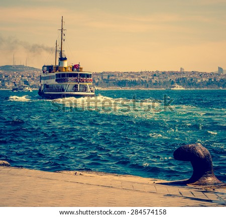 Sea voyage to Bosporus on the ferryboat. Turkish steamboat in Istanbul pier at sunset. Vintage passenger ship in retro style. - stock photo