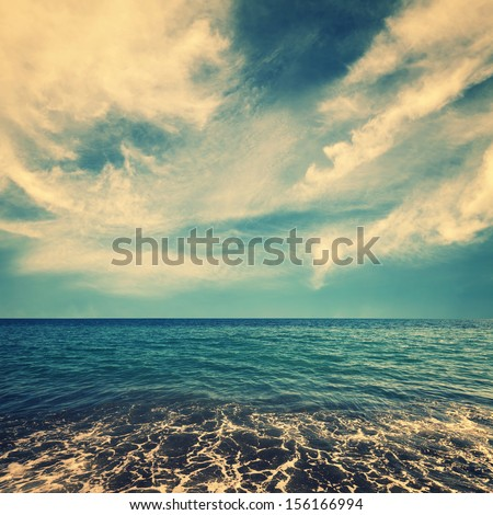 sea water and beautiful clouds on sky, retro colors - stock photo