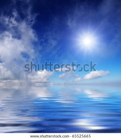 Sea water and blue sky with cloud and sun