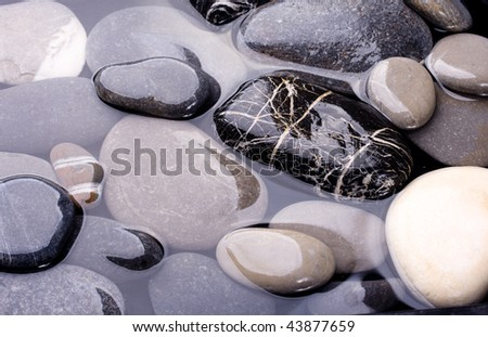 Sea water and stones - stock photo