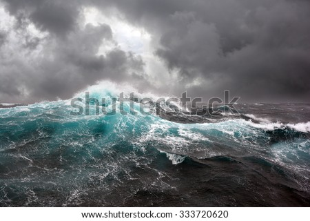 sea wave and dark clouds on background - stock photo