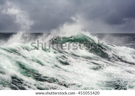 sea wave and dark clouds on background