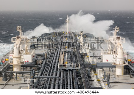 Sea wave and fore of the oil tanker. - stock photo
