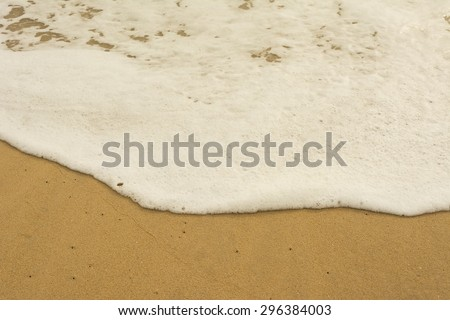 Sea wave and many foot print on the beach background,Soft-Focus