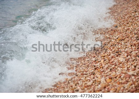 Sea wave and pebble. Natural composition