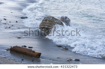 Sea wave and stones