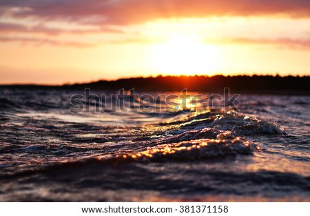 sea wave close up at sunset, low angle view, cross processing effect - stock photo