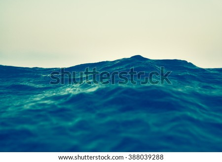 sea wave close up, low angle view, retro style effect