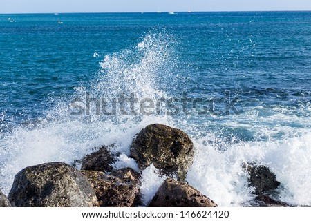 Sea wave hit the rock - stock photo