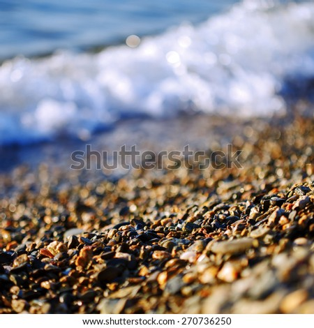 Sea wave incident on the coastal shingle. - stock photo