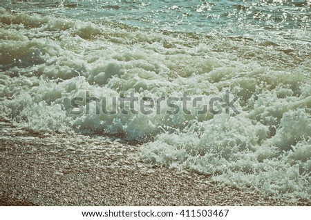 Sea wave splashing to the coast, natural vintage background
