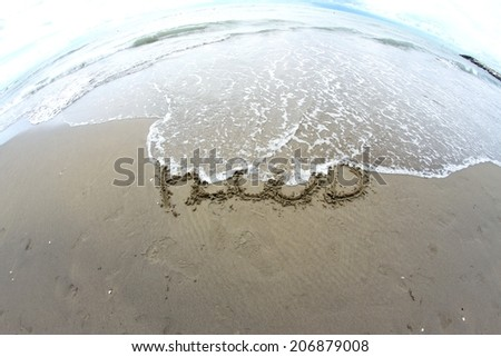 sea wave that erases the word flood on the Sea Beach photographed by fisheye lens 3 - stock photo