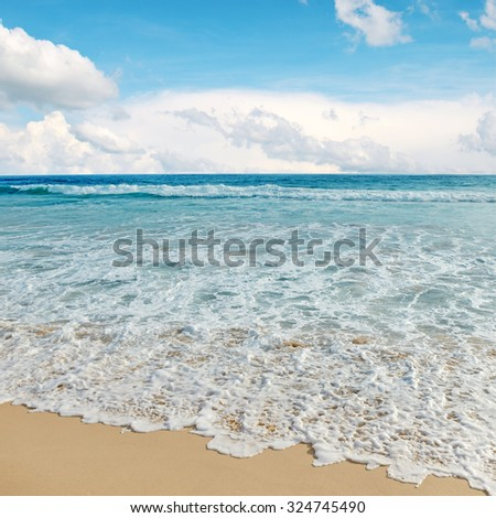 sea waves and blue sky - stock photo