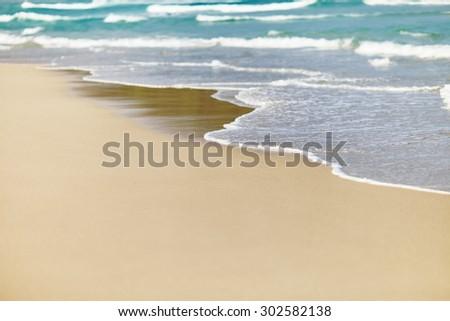 Sea waves and sandy beach  - stock photo