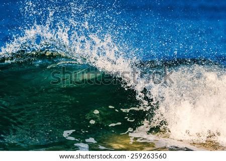 Sea waves break on the shore  - stock photo