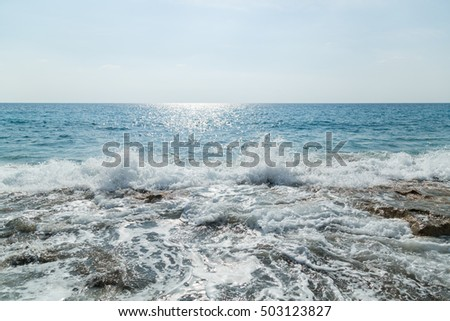 sea waves breaking on a stone