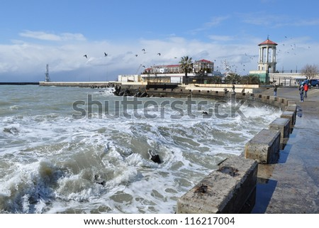 Sea waves breaking on concrete port