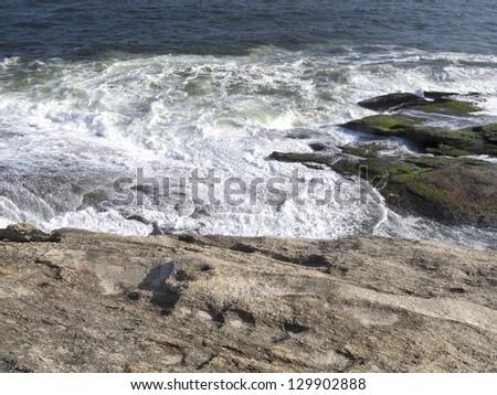 Sea waves bursting the rocks - sparkling waters forming wonderful landscape - Rio de Janeiro - Brazil - stock photo