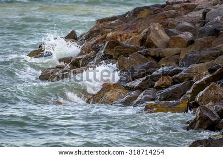 Sea waves hit the rock splash on the coast, Waves hitting rocky shore - stock photo