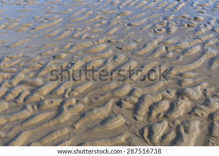 Sea Waves touching sandy beach  - stock photo
