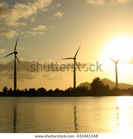 Sea wind station at sunrise time - stock photo
