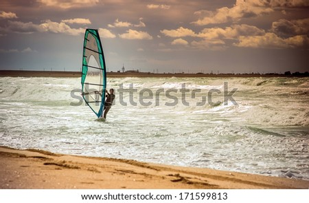 Sea Windsurfing Sport sailing water active leisure Windsurfer training on waves summer day Lifestyle concept