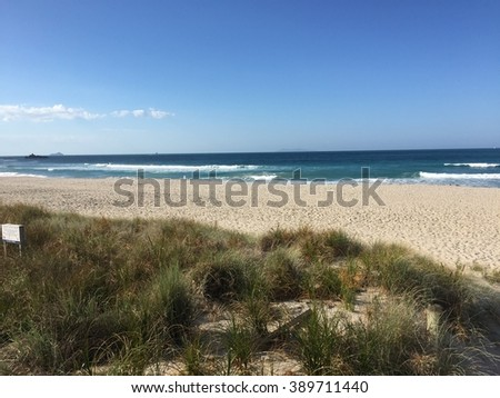 Sea with blue sky, sand, wave, sunset, cloud and marine
