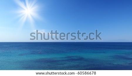 Sea with sun and blue sky in Croatia - stock photo