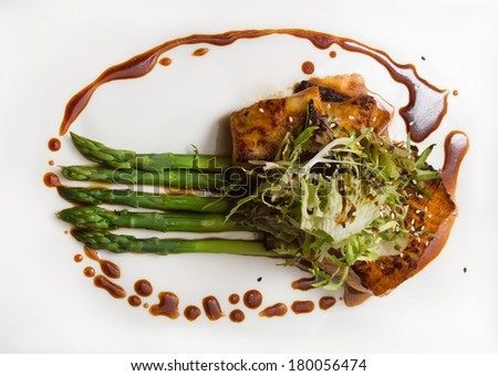 Seabass fillet with asparagus - stock photo